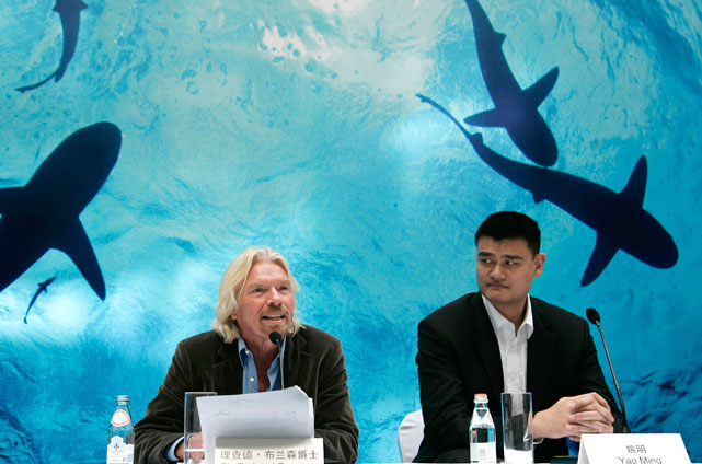Yao and British tycoon Richard Branson attend a press conference for a campaign against eating shark fins in Shanghai. Yao and Branson made an appeal Thursday in Shanghai against the consumption of shark fins to a group of 30 of China's richest and most influential business people.