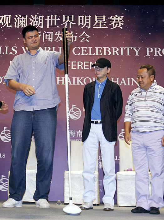 Yao is joined by top director Feng Xiaogang and Hong Kong actor Eric Tsang during the press conference for Mission Hills 2012 World Celebrity Pro-Am in Shanghai.