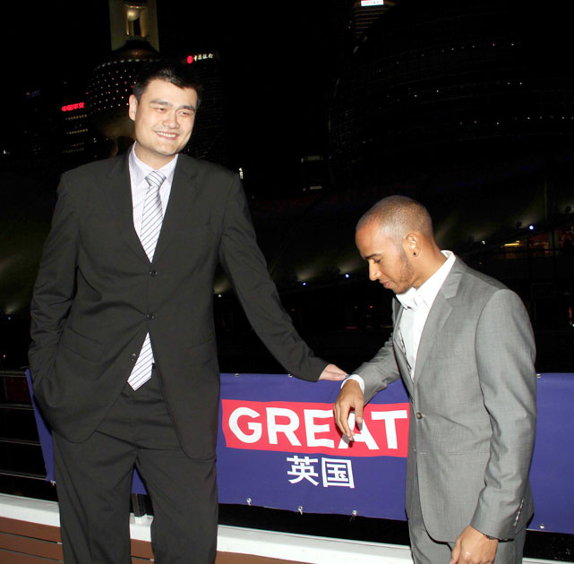 Yao and British F1 driver Lewis Hamilton attend a charity event during the UKs GREAT campaign on a sightseeing boat in Shanghai.
