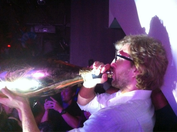 "Dallas sports radio personality Jeff ""Skin"" Wade snapped this photo of Mavs forward Dirk Nowitzki celebrating his first NBA title with an oversized bottle of champagne."
