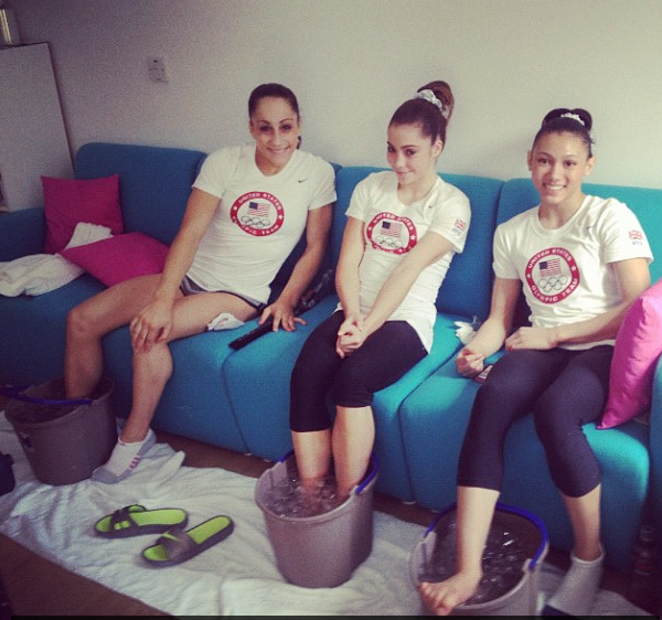 McKayla Maroney's unhappy face became an internet sensation during the London Olympics, but in this photo, Maroney (middle) was more than happy to rest her aching feet in a bucket of ice between U.S. gymnastics teammates Jordyn Wieber and Kayla Ross.