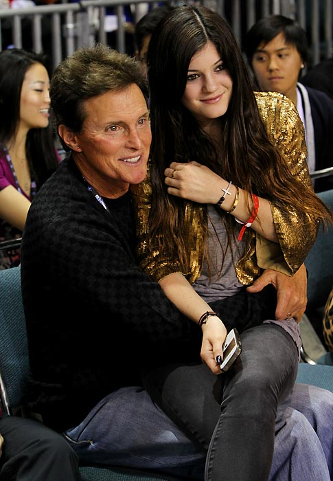 Bruce Jenner and Kylie Jenner react to a play during the 2011 NBA All-Star Celebrity Game in Los Angeles.