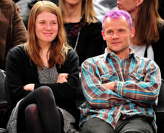 Flea of the Red Hot Chili Peppers and daughter Clara Balzary at a Milwaukee Bucks-New York Knicks game.
