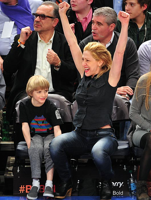 Edie Falco and son Anderson at an Indiana Pacers-New York Knicks game at Madison Square Garden.