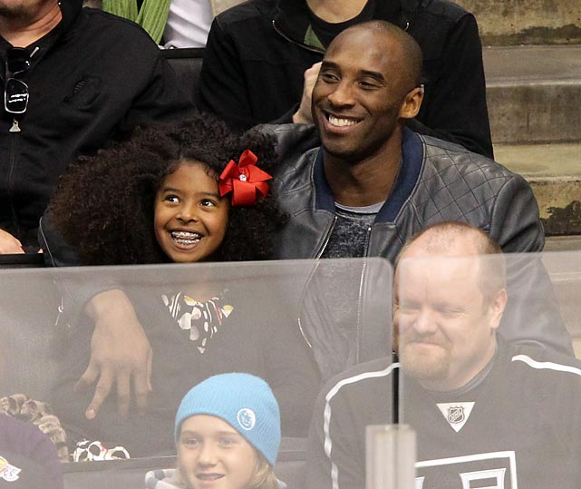 Kobe Bryant and his daughter Natalia attend a playoff hockey game between the Vancouver Canucks and the Los Angeles Kings at Staples Center.