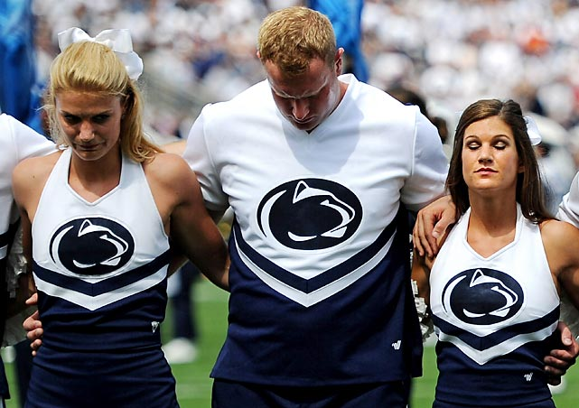 Penn State cheerleaders during a pregame moment of silence for victims of child abuse.