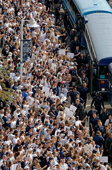 Penn State fans cheer as the team bus arrives at Beaver Stadium for the Ohio game.