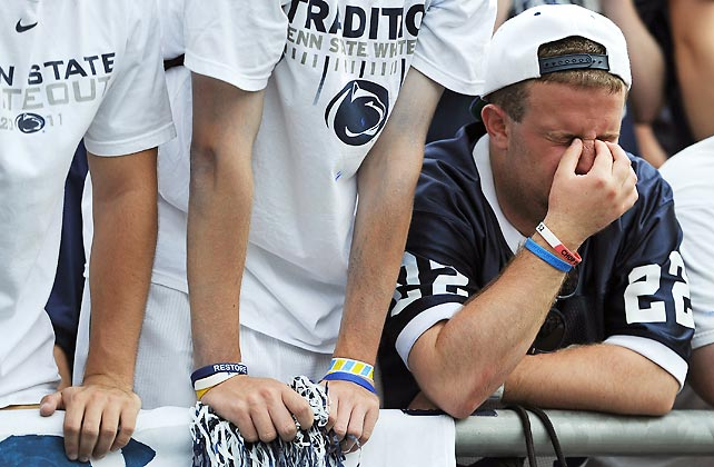 A Penn State fan reacts to the team's upset loss to Ohio.
