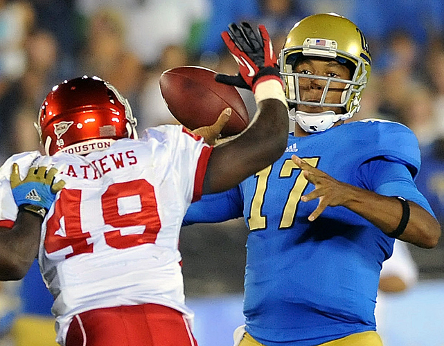 "No. 22 UCLA showed what it can do on offense in its first two games of the season, rolling up 85 points and 1,299 yards. Redshirt freshman Brett Hundley (right) passed for 320 yards and two touchdowns, and the hard-hitting Bruins held high-scoring Houston in check. ""We played outstanding defense tonight except for one play,"" said first-year coach Jim Mora, referring to an 86-yard run by Houston's David Piland with 4:54 remaining that kept the Cougars from being shut out for the first time in nearly 12 years."