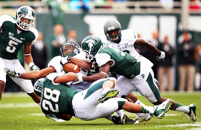 Michigan State's offense struggled mightily for much of this game, and the Spartans trailed 7-6 midway through the third quarter. But Sparty stayed in it thanks to a suffocating defense that smothered running back Dominique Sherrer (pictured) and Eastern Michigan, holding the Eagles to eight first downs.