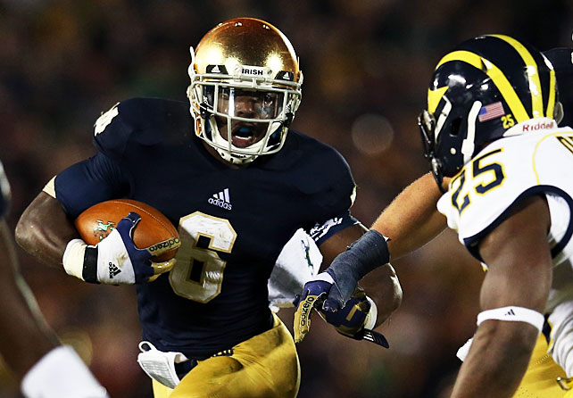 The game may have been filled with errors, but Notre Dame stayed unbeaten by taking down Michigan. Tommy Rees replaced Everett Golson and threw for 115 yards, and running back Theo Riddick (pictured) carried 17 times for 51 yards. The real story of the game was the defense. The Irish forced six turnovers -- including four Denard Robinson interceptions.