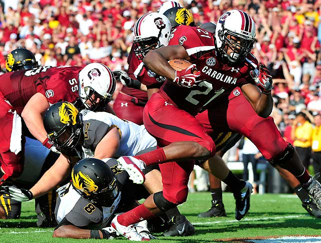 Missouri didn't find Columbia, S.C., quite as welcoming as Columbia, Mo. The Tigers struggled in their first SEC road game, managing just 12 first downs. Meanwhile, Marcus Lattimore (pictured) had a big day for the Gamecocks, rushing 21 times for 86 yards and two touchdowns and catching seven passes for 61 additional yards.