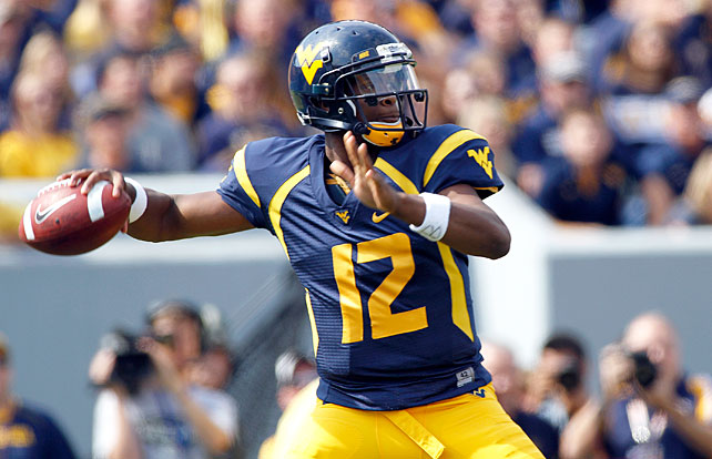 There are shootouts, and then there was West Virginia's historic Big 12 debut against Baylor. The Mountaineers and Bears combined for 1,507 total yards, 67 first downs and 133 points in a game full of eye-popping statistics. WVU quarterback Geno Smith (pictured) threw for 656 yards and eight touchdowns, and wide receiver Stedman Bailey racked up 303 receiving yards and five scores. Baylor quarterback Nick Florence threw for 581 yards and five touchdowns and wideout Terrance Williams amassed 314 receiving yards and two scores in defeat.