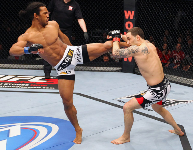 Benson Henderson outlasted Frankie Edgar at UFC 144 to win the lightweight title by unanimous decision. Less than seven months later, Henderson beat Edgar again (this time by split decision) to retain the belt and defend his title.