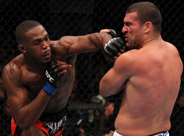 "At 23, Jon Jones became the youngest UFC champion in history when he downed then-champ Mauricio ""Shogun"" Rua at UFC 128. Since then, Jones (16-1) has successfully defended his belt against Lyoto Machida, Quinton ""Rampage"" Jackson and Rashad Evans and made a case to be considered MMA's pound-for-pound king."