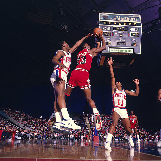 Thomas (right) and Michael Jordan went head-to-head several times throughout their careers, and while Thomas never neared Jordan's championship record, his Pistons thrice vanquished the Bulls from the playoffs (in four postseason matchups).