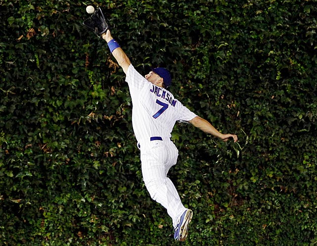 Chicago Cubs center fielder Brett Jackson stretches out to catch a fly ball hit by Milwaukee Brewers' Rickie Weeks.