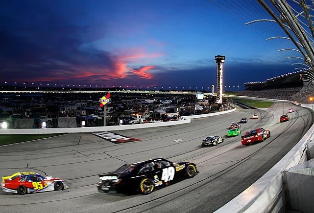 Cars race through turn four during the NASCAR Sprint Cup Series race at Atlanta Motor Speedway.