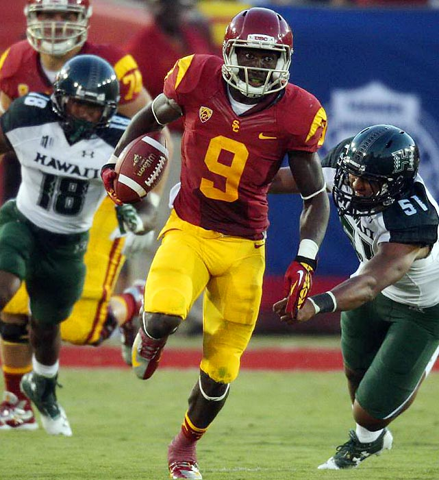 USC's Marqise Lee runs away from the Hawaii defense during the Trojans' 49-10 over the Warriors. Lee terrorized Hawaii's defense for 10 catches for 197 yards and one touchdown along with returning a kickoff for a touchdown.