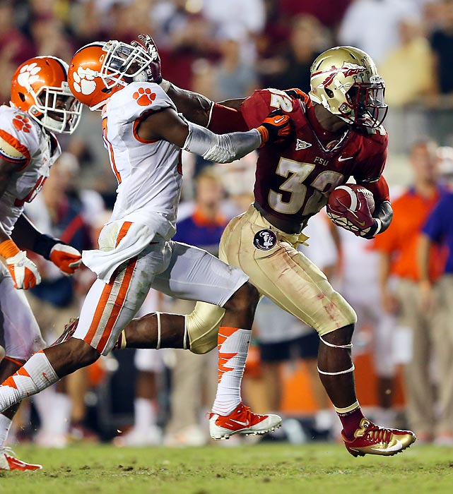 Florida State's James Wilder Jr. runs away from Clemson's Bashaud Breeland during the Seminoles' victory over the Tigers at Doak Campbell Stadium.