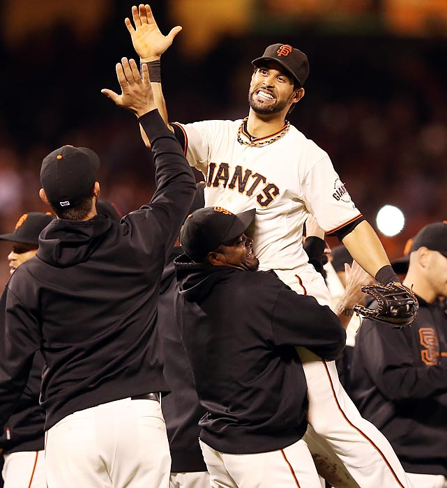 San Francisco's Angel Pagan celebrates with his teammates after the Giants beat the San Diego Padres to clinch the National League West.
