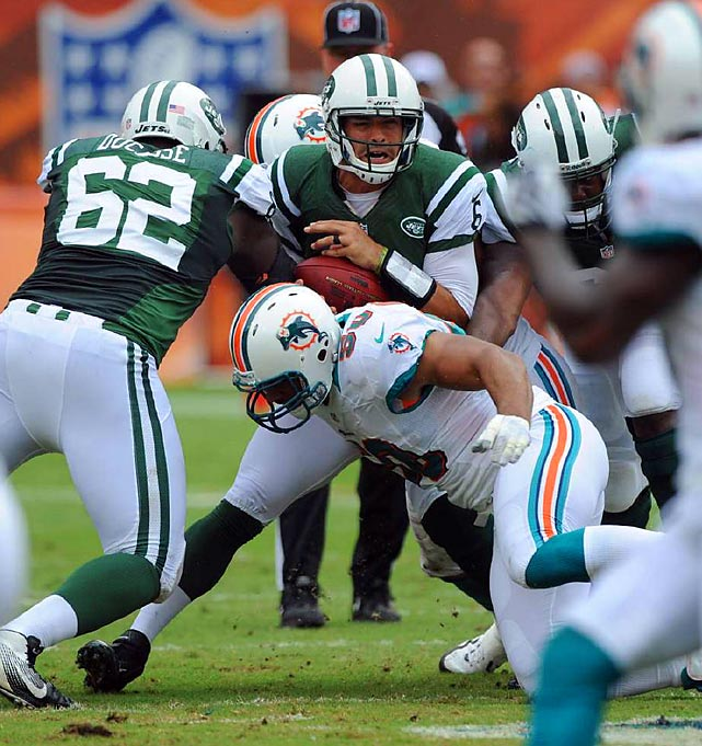 New York's Mark Sanchez can't escape the grasp of a Miami defender during the Jets' 23-20 overtime win over the Dolphins.