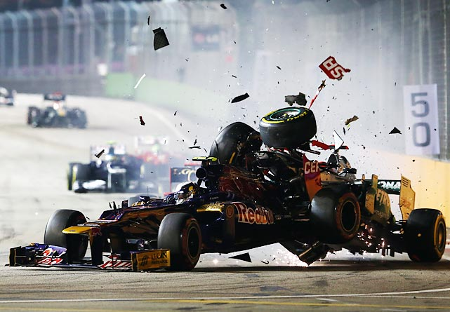 Michael Schumacher of Germany and Mercedes GP crashes into the back of Jean-Eric Vergne of France and Scuderia Toro Rosso during the Singapore Formula One Grand Prix at the Marina Bay Street Circuit in Singapore..
