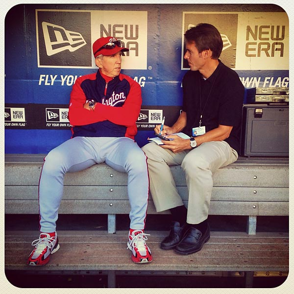 Nationals manager Davey Johnson is interviewed in the dugout by SI writer Tom Verducci.