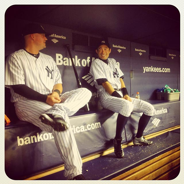 Ichiro Suzuki and Casey McGehee joke around in the dugout during game against the Rays.