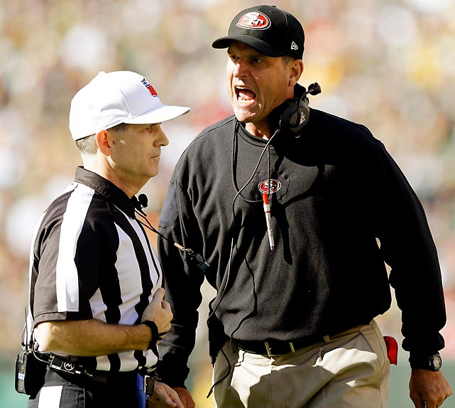 Jim Harbaugh screams at referee David White in San Francisco's opener against Green Bay. Harbaugh has been caught by cameras frequently losing his temper with the referees and has drawn the ire of the NFL.