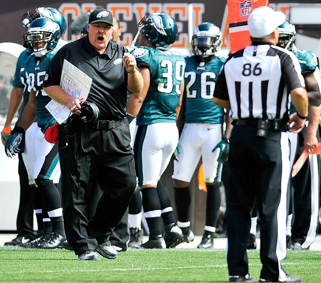 Andy Reid yells at referee Ken Roan from afar in the Eagles' opener against Cleveland.