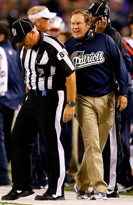 Bill Belichick yells at an official after a pass interference call on the Patriots during their Week 3 game at Baltimore. After the game, an irate Belichick ran up to one of the officials and grabbed his arm. The NFL fined the New England coach $50,000.