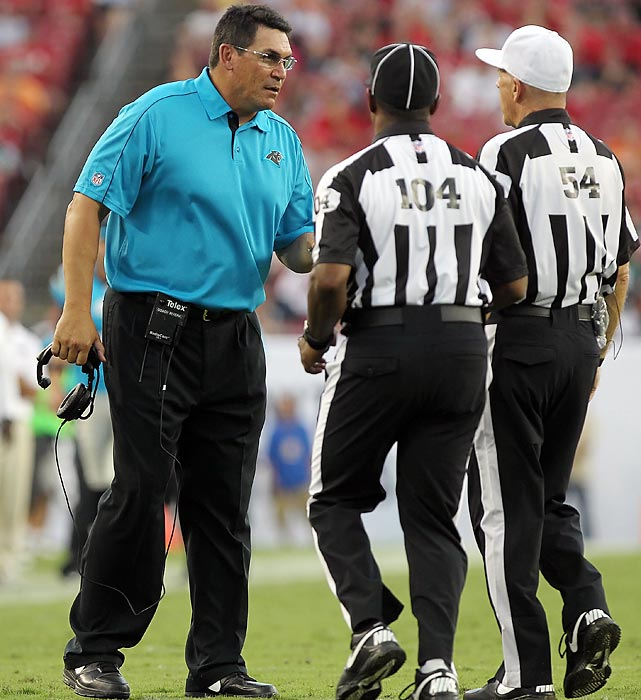 Carolina head coach Ron Rivera approaches two officials during a game against the Tampa Bay Buccaneers.
