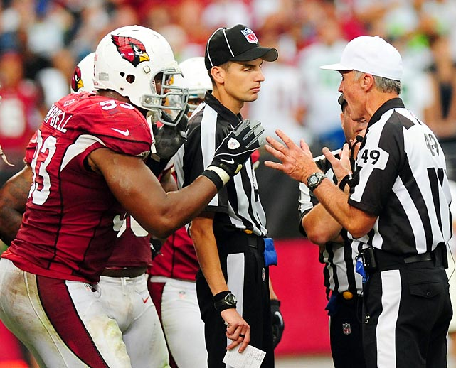 Arizona running back William Powell frantically argues with the officials during the fourth quarter against Seattle.