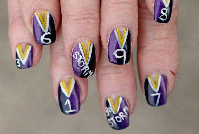 A Melbourne Storm supporter shows off her team spirit.