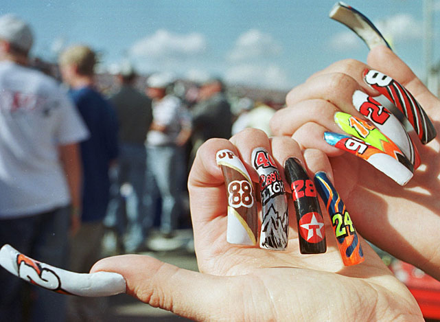 Not to be outdone, another NASCAR fan shows off her nails before the 2001 EA Sports 500.