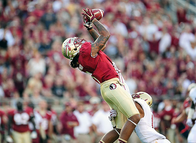 One week after suffering a stunning upset loss at NC State, the Seminoles responded in resounding fashion against Boston College. EJ Manuel threw for 424 yards and four scores, and Florida State's receiving targets went off: James Wilder Jr., Kenny Shaw and Kelvin Benjamin (pictured) all made touchdown catches in the game. The 'Noles outgained the Eagles 649 yards to 225.