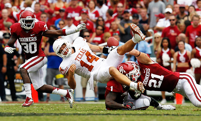 The Red River Rivalry was anything but Saturday, as Oklahoma easily emerged victorious in a one-sided affair. Texas' once-vaunted defense couldn't stop Oklahoma backup quarterback Blake Bell, who rushed for four touchdowns. Oklahoma's defense, meanwhile, suffocated Texas quarterback David Ash (pictured) who fumbled once and threw two interceptions.