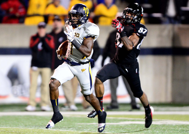 Toledo spoiled No. 21 Cincinnati's perfect season by handing the Bearcats their first loss of the season. Bernard Reedy (pictured) scored on a 91-yard kickoff return to put the Rockets up 26-20 in the fourth quarter, a lead they would maintain. The score marked Reedy's third TD on special teams in three weeks.