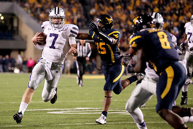 Geno Smith's Heisman hopes and West Virginia's Big 12 title hopes are all but over. Collin Klein's Heisman hopes and Kansas State's Big 12 title hopes are very much alive. Klein (pictured) passed for 321 yards and three touchdowns and rushed for 43 yards and four touchdowns as the Wildcats shredded the Mountaineers' porous defense.