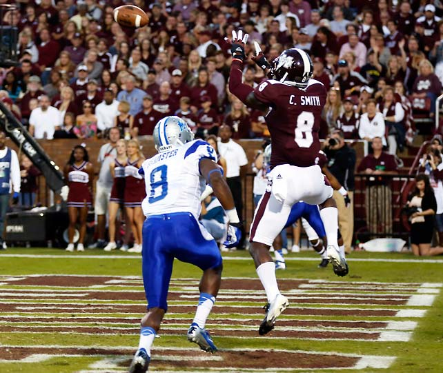 Mississippi State easily beat Middle Tennessee State to improve to 7-0 and set up a big Week 9 showdown with fellow SEC West undefeated team Alabama. Chris Smith (pictured) caught a career-high seven passes for 66 yards and two touchdowns, while Johnthan Banks tied the Bulldogs' record with his 16th career interception.