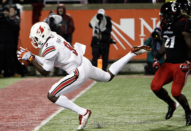 Louisville remained perfect, but it needed overtime to do so. The Cardinals intercepted Munchie Legaux in the extra frame, then survived a botched icing-the-kicker attempt to nail a 30-yard field goal and win the game. Teddy Bridgewater threw two touchdowns to DeVante Parker (pictured) to help force overtime after falling behind 24-14 in the third quarter.