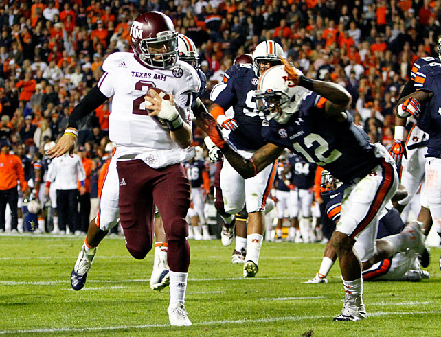 Texas A&M didn't take any time to dwell on last week's loss to LSU. The Aggies thumped a reeling Auburn squad behind another standout performance from redshirt freshman Johnny Manziel (pictured). Johnny Football amassed 330 total yards and five touchdowns, and true freshman running back Trey Williams carried 19 times for 109 yards and a score. A&M improved to 6-2 with the result, while the Tigers dropped to 1-7 and 0-6 in SEC play.