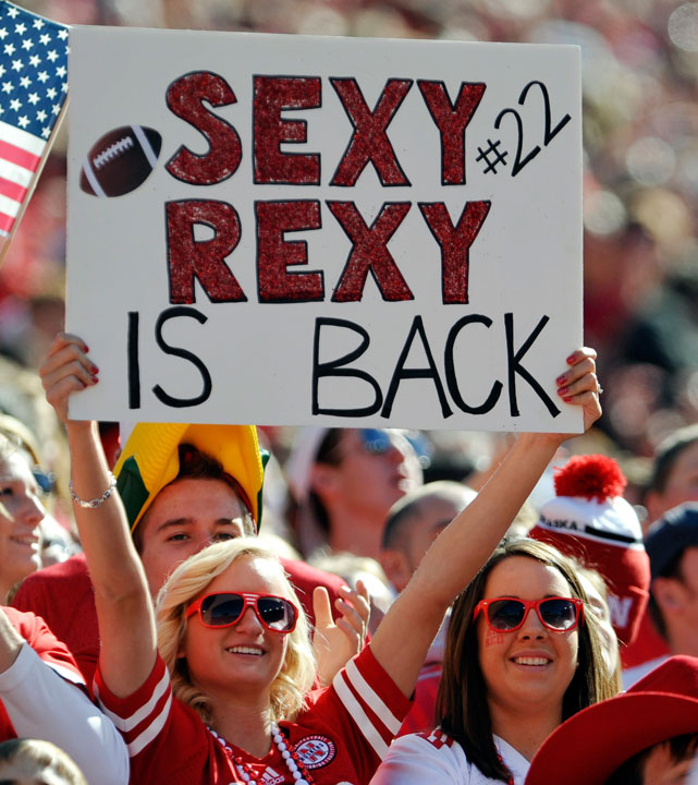 A Rex Burkhead proudly holds up her sign during a Nebraska-Idaho State game.