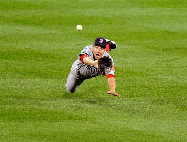 The Red Sox' Scott Podsednik dives for and misses a double in the fifth inning by the Orioles' Manny Machado.