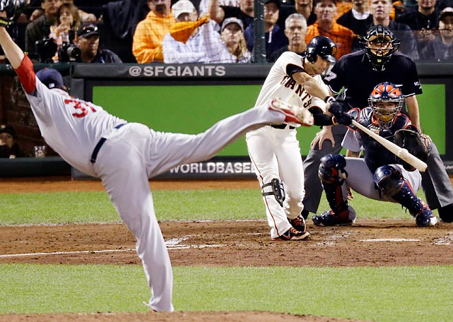 The Giants' Gregor Blanco hits a triple off of the Cardinals' Lance Lynn during the fourth inning of Game 1 of the NLCS.