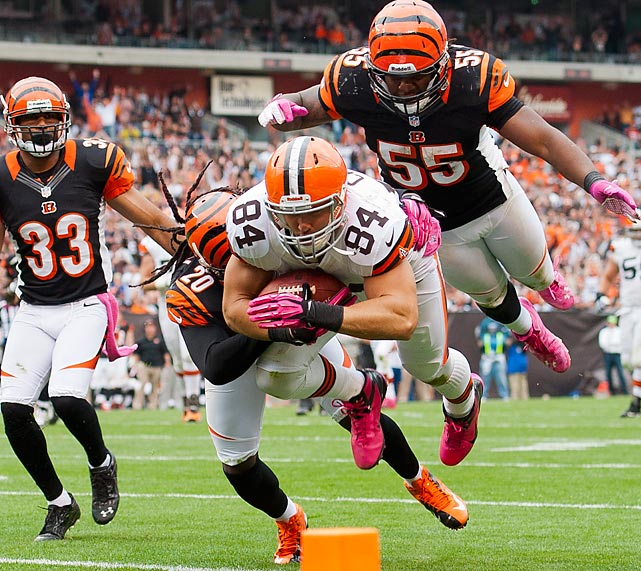 Browns tight end Jordan Cameron dives for extra yards while under pressure from Cincinnati free safety Reggie Nelson, outside linebacker Vontaze Burfict and defensive back Chris Crocker during the fourth quarter at Cleveland Browns Stadium. The Browns defeated the Bengals 34-24.