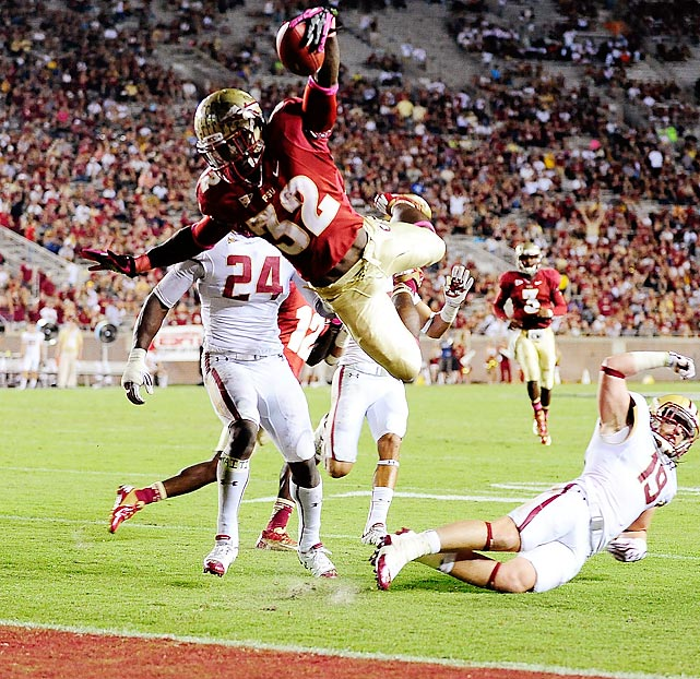 Florida State's James Wilder Jr. leaps over Boston College's Sean Sylvia for a touchdown during a game at Doak Campbell Stadium. Florida State easily dispatched of the Eagles, 51-7.