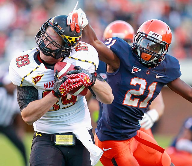 Maryland tight end Matt Furstenburg catches the ball in front of Virginia safety Brandon Phelps, who can only get his hand on Furstenburg's helmet.