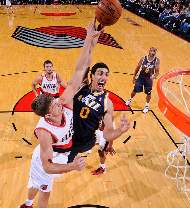 Jazz center Enes Kanter goes up for a shot against Meyers Leonard during a preseason game in Portland, Oregon